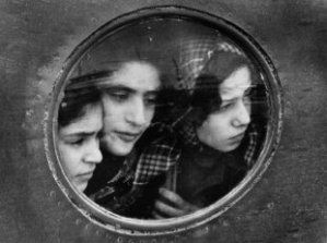 immigrant-jewish-girls-looking-out-through-port-holeestate_of_ruth_orkin_jewish_refugees_at_lydda_airport_tel_aviv_1951c_20_2089_41