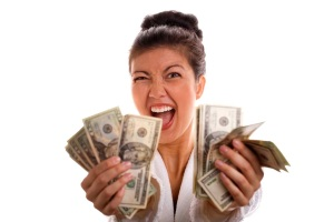 happy-girl-holding-cash-in-hands